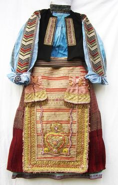 Bulgarian women folk costume from Banat, linen shirt and skirt with geometrical motives sewed with golden thread and colored silk, silk apron and golden lace, pleated wool skirt and golden thread. Specific blue color of shirt and skirt. Over 80 years old.