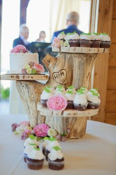 Rustic custom-made wooden cake stand with initials soldered into the wood.  Absolutely love this rustic wedding decor item! #weddingcake #cakestand #receptiondecor #mwri