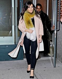Kim Kardashian steps out wearing a fur stole with Kanye West on Feb. 23