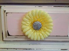 Silk flowers added behind drawer pulls for little girls room...too cute!