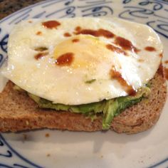 Open face sandwich - sprouted bread, avocado, egg and splash of ...
