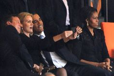 "Barack hates photo-ops (acc. to him) SO much he creates them at memorial services with blondes while his MOOchie sulks as only she can do. No, Barack loves photo-ops as long as they don't make him ""own"" unpleasant situations he created such as illegal immigration. He'd rather drink beer and shoot pool. Moo just loves sulking."