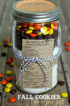fall cookies in a jar: 1 1/2 cups flour + 1/2 tsp. baking soda + 1/s tsp. baking powder + 1/2 tsp. salt + 1/2 cup brown sugar + 1/2 cup sugar + 2/3 cup milk chocolate chips + 2/3 cup reeses pieces ...