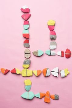The House That Lars Built.: Color rock dominoes