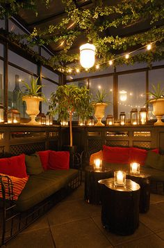 Dark colored couches and countless votive candles create a serene feel for this evening affair.