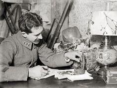 A French soldier with his kittens on the Western Front, Argonne 1916