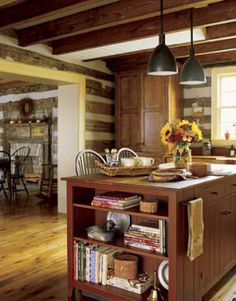 This log cabin's kitchen boasts the functionality of a farmhouse cookery with the appeal of simple Shaker style.