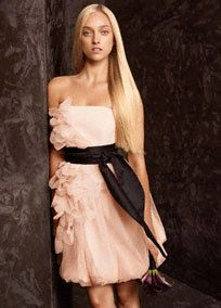 Short modern bridesmaid dress features organza petal detailing and Black satin sash. #davidsbridal #whitebyverawang