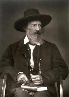 """Alfred, Lord Tennyson, first Baron Tennyson (1809-1892), Victorian poet and Poet Laureate, with book.  I built my soul a lordly pleasure-house, Wherein at ease for aye to dwell. I said, """"O Soul, make merry and carouse, Dear soul, for all is well."""" """"The Palace of Art"""", st. 1 (1832)."""