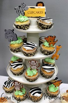 Safari theme cupcakes with cute animal toppers and animal print cupcake holders.