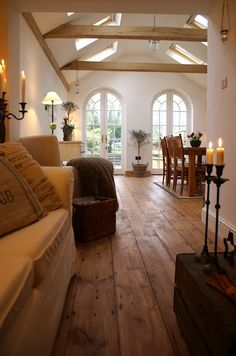 hardwood floors, beams, skylights, clean white, arched windows