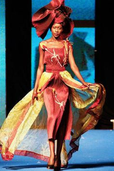 A model wears a creation by Senegalese designer Oumou Sy during the 10th anniversary of Dakar Fashion Week
