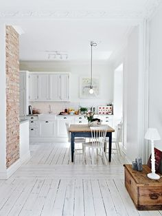 exposed brick wall in white kitchen via Decordots, photo from http://www.stadshem.se/