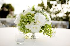 A May centerpiece of hydrangeas, peonies, and queen anne's lace