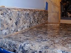 Faux granite countertops using paint. Doing this soon, I'm tired of my 1970's gold marble-esque counters.