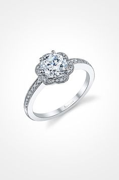 A stunning platinum engagement ring from Sylvie showcases a classic floral design.