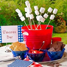 4th of July Party Food Ideas: Get your s'mores on! Almost as American as apple pie, s'mores are the perfect ending for your patriotic party. Instead of making guests juggle marshmallow bags and graham crackers around the fire pit, set up a s'mores bar to serve individual ingredients in a far more civilized fashion. Don't forget the napkins – s'mores are messy!