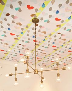 So fun. Ceiling painted with hearts and grid. Amazing gold light fixture.