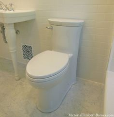 Skirted toilet. Concealed Trapway.  American Standard Tropic, Right Height Elongated, One-Piece, ADA Toilet.