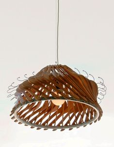 A lamp made from recycled wood clothes hangers Gloucestershire Resource Centre www.grcltd.org