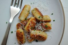 3 Russet potatoes 2 Eggs 1 c. Ricotta 1/2 c. Grated parmesan 1/3 c. Chives 2 c. Flour (making sure you have extra on hand for rolling them l...