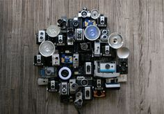old cameras as wall art. . . Jim will think this blasphemy