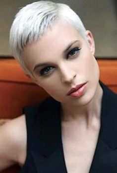 Short white hair- focus is more on her eyes and lips. White hair is for any age with the right cut