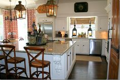 lantern lighting, bamboo blinds, bread boards, tole tray -cozy kitchen