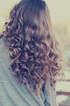 long curly brown hair!