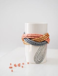 Love this tutorial: use Hama beads and memory wire to make a stack of gorgeous cuff bracelets for less than $10, via Tuts+. #Hama #bracelets #FreeTutorial