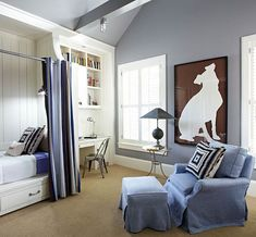 built in bed with nautical overhead sconce, tolix desk chair, & over-sized wall art.  beautiful wall color.