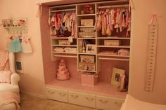 Holy Nursery Organization! And we love the wallpapered closet in this vintage pink nursery. #nursery #organization #vintage