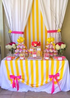 Candy table decor - different colors. Like the looks of the table cloth and bows.