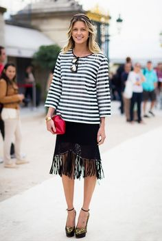 Helena Bordon pulls off gold tiger-print platform pumps with a boxy striped shirt and fringe skirt.