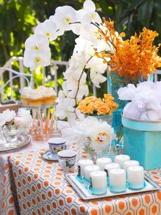 Orange, turquoise and white... beautiful table for outdoor entertaining.