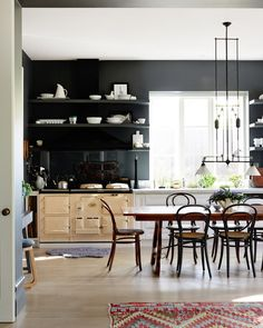 Love the dark wall in this kitchen.