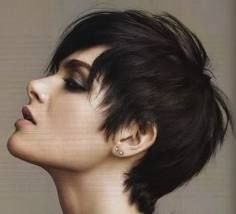 choppy pixie cut with a long side fringe