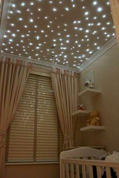 fiber optic star lights baby nursery ceiling -- i also love the ceiling the same color as the wall with the white crown molding!