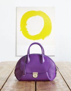 Fiamma in grape leather on location in Brooklyn, New York. Explore #theFIAMMA at www.Ferragamo.com/Fiamma.