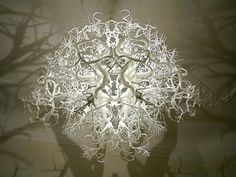 This remarkable chandelier from Hilden & Diaz projects a 360° shadow of trees and roots onto the walls surrounding it.