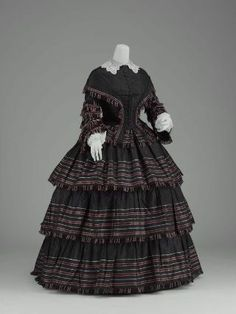 Woman's two-piece day dress  American, about 1855  United States  DIMENSIONS  Bodice: 56cm (22 1/16in.); skirt: 110cm (43 5/16in.)  MEDIUM OR TECHNIQUE  Silk plain weave (taffeta) with weft-float patterning (à la disposition)