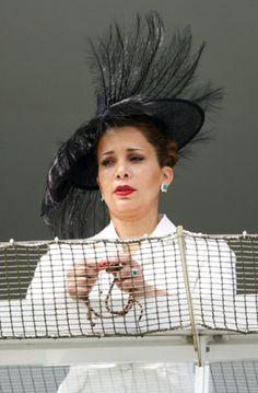Princess Haya bint Al Hussein holds Rosary beads as she watches the racing on Derby Day of the Investec Derby Festival at Epsom Racecourse, 07.06.2014 in Epsom, England.
