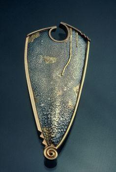 Tom McCarthy Jewelry, Shield Brooch    Sterling, 14K, 18K & 22K gold, nickel silver, diamond