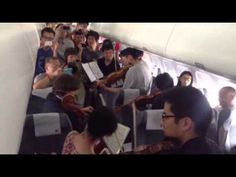 Check out these dreamers.......... How about this for a delayed flight ??? ... The #Philadelphia #Orchestra made the best of things while delayed on the Tarmac in Beijing :)))))