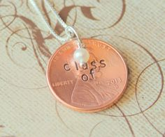 """Cute idea for graduation- stamp """"Class Of"""" on this years penny and string on necklace for grad. #yearofcelebrations"""