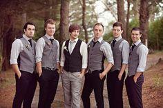 Groomsmen - gray vests w/purple ties, dark gray slacks. groom w/green tie