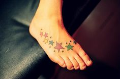 Color star tattoos on foot