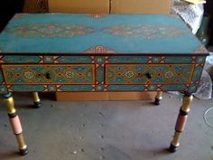Zeen Designs' Flickr page has lots of gorgeous painted wood furniture!