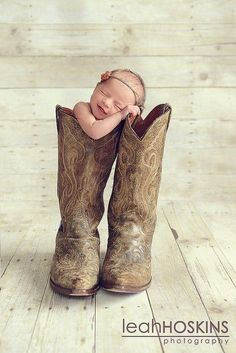 Baby in a boot. my child. Love.