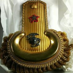 This epaulette belonged to Brigadier General John Lejeune, who went on to serve as the 13th Commandant of the Marine Corps. He served for nearly 40 years. His service included commanding the U.S. Army 2nd Infantry Division during World War I.    Semper Fidelis  #USMC #USA #USArmy #NMMC #WWI #Commandant #Marines #Leatherneck #DevilDog #USMCmuseum #SemperFi #Lejeune #Quantico